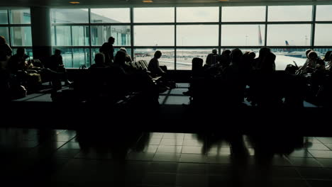 Silhouetted-People-in-Airport-Terminal