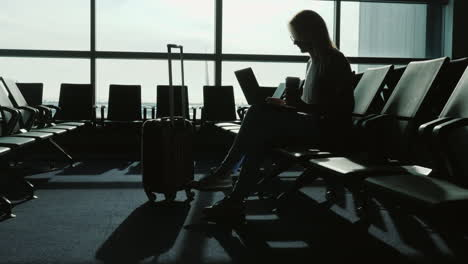 Business-Woman-Working-While-Waiting-For-Flight