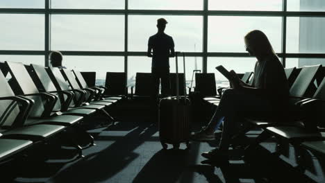 People-Waiting-For-Flight-Silhouettes