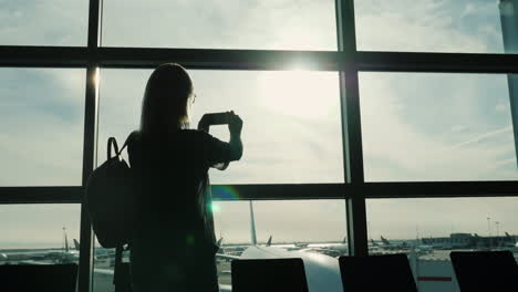 Woman-Taking-Pictures-From-Airport-Terminal