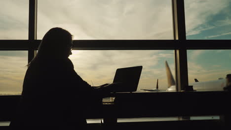 Businesswoman-Working-In-Airport-Terminal