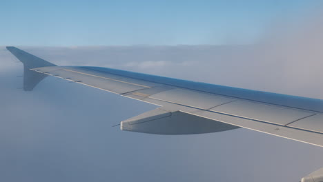 Airplane-Wing-With-Clouds-and-Turbulence