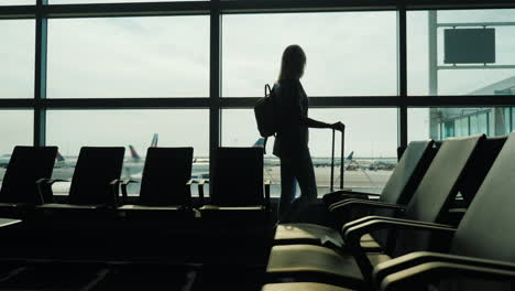 Woman-Watches-Planes-in-Airport