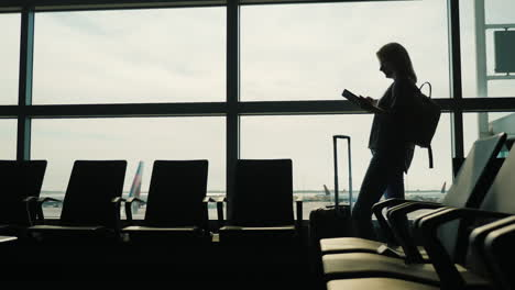 Woman-in-Airport-Using-a-Tablet