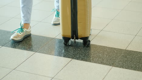 Woman-Wheels-Suitcase
