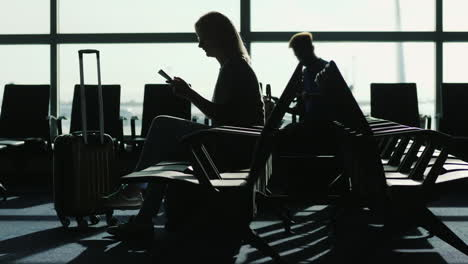 Woman-in-an-Airport-Using-a-Tablet
