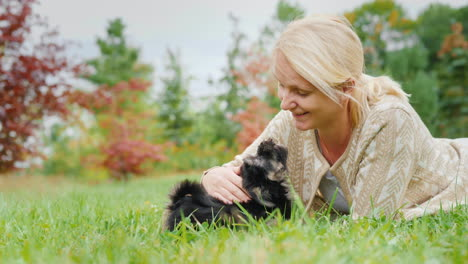 Woman-Playing-With-Two-Puppies