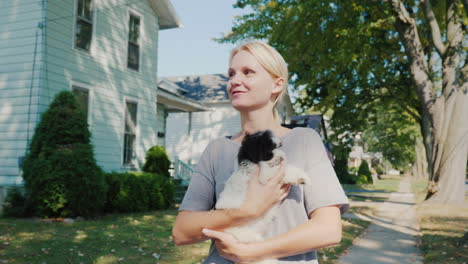 Woman-Walking-A-Puppy-In-Her-Arms