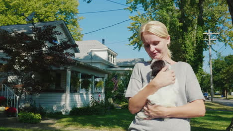 Woman-Holds-a-Puppy-While-Walking