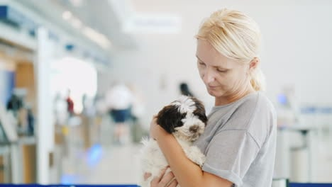 Woman-Holding-Puppy-in-an-Airport