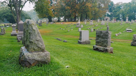 Cemetery-Gravestones-On-Green-Grass