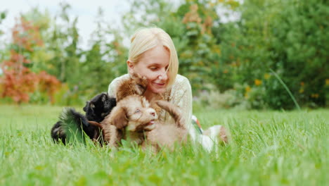Woman-Playing-With-Puppies