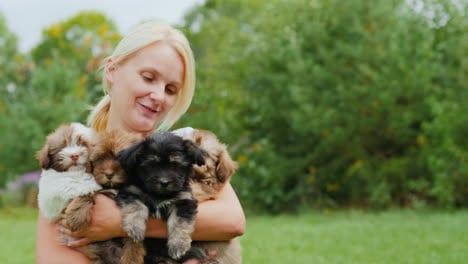 Happy-Woman-Holding-Cute-Puppies