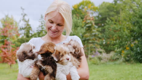 Woman-Holding-Several-Puppies