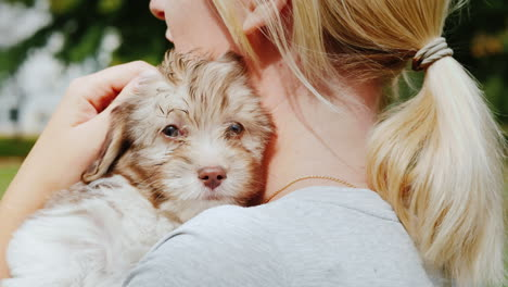 Woman-Cuddling-Cute-Puppy