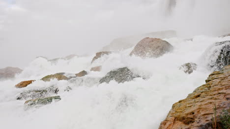 Water-Crashing-On-Rocks-At-Base-Of-Niagara-Falls