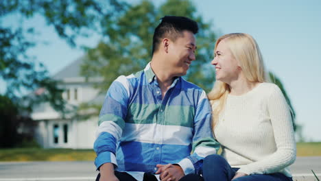 Asian-Man-And-Caucasian-Woman-by-House