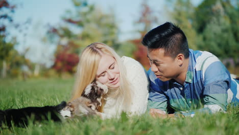 Young-Couple-and-Puppies