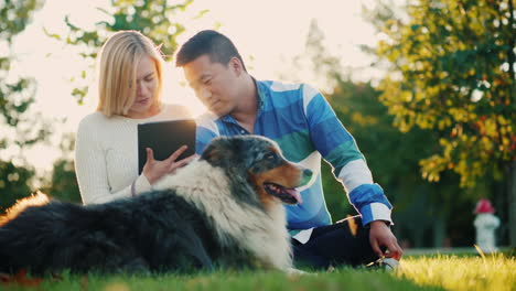 Couple-Using-a-Tablet-With-Dog-Nearby