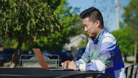 Man-Working-On-Laptop-Outdoors