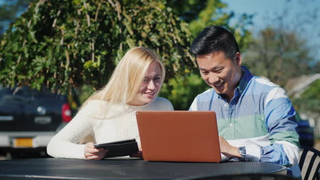 Man-and-Woman-With-Tablet-and-Laptop