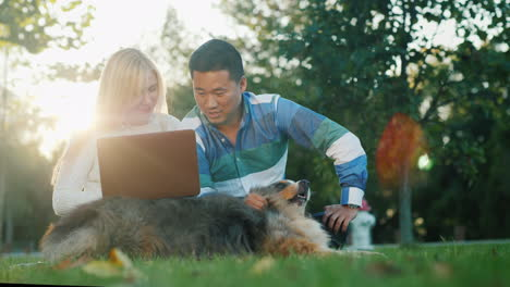 Couple-With-a-Dog-Using-a-Laptop