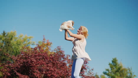 Woman-Jumping-With-a-Puppy