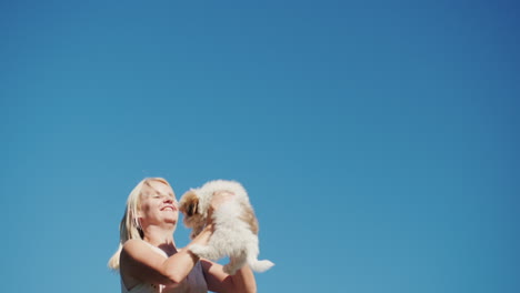 Woman-Jumps-With-a-Puppy