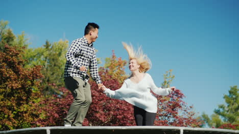 Young-Couple-on-Trampoline