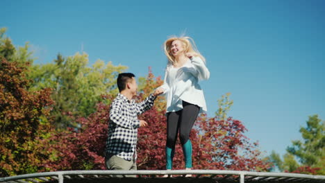 Couple-Have-Fun-on-Trampoline