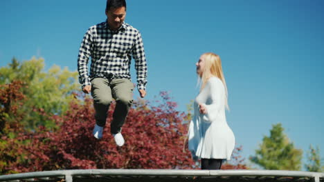 Man-and-Woman-Jump-on-Trampoline