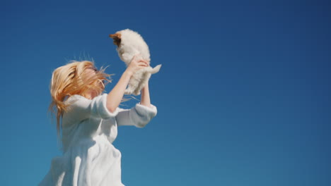 Young-Woman-Jumping-With-Puppy