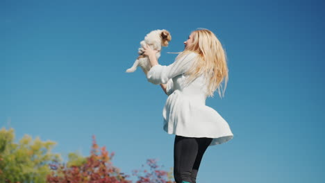 Woman-Holding-Puppy-Jumping