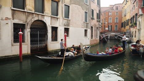 Gondolas-With-Tourists-Sail-Venice