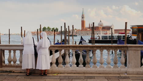 Two-Nuns-Admire-View-Of-Venice