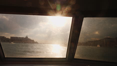 Venice-Through-Boat-Window-at-Sunset