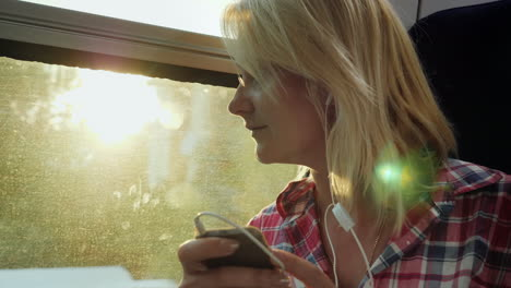 Young-Woman-On-A-Train-Using-A-Phone