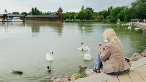 Young-Woman-Uses-A-Smartphone-by-Water