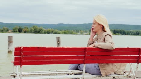 Woman-On-A-Bench-Talks-on-Phone