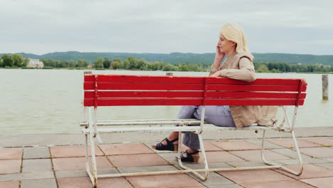 Woman-On-A-Bench-Makes-a-Phone-Call