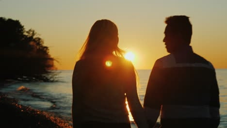 Couple-Walk-on-Beach-at-Sunset