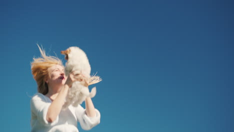 Young-Woman-on-Trampoline-Holding-Puppy