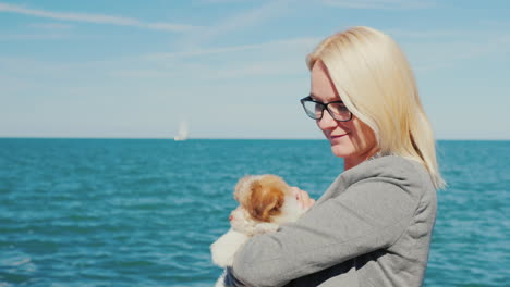 Woman-With-Puppy-by-the-Sea
