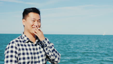 Asian-Smoking-by-the-Sea
