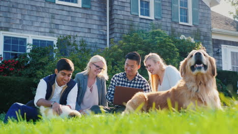 Group-of-Friends-With-Dogs-and-Laptop