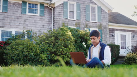 Man-Works-on-Laptop-in-Backyard