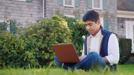 Man-Works-on-Laptop-in-Yard