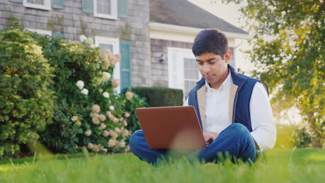 Man-Uses-Laptop-in-Backyard