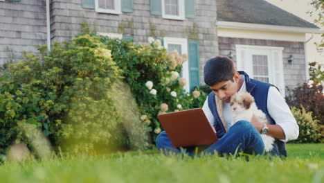 Man-With-Puppy-Using-Laptop