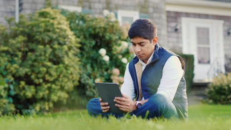 Man-Uses-Tablet-in-Backyard